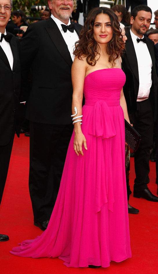 Salma Hayek in Saint Laurent, with Boucheron jewelry and a Saint Laurent clutch